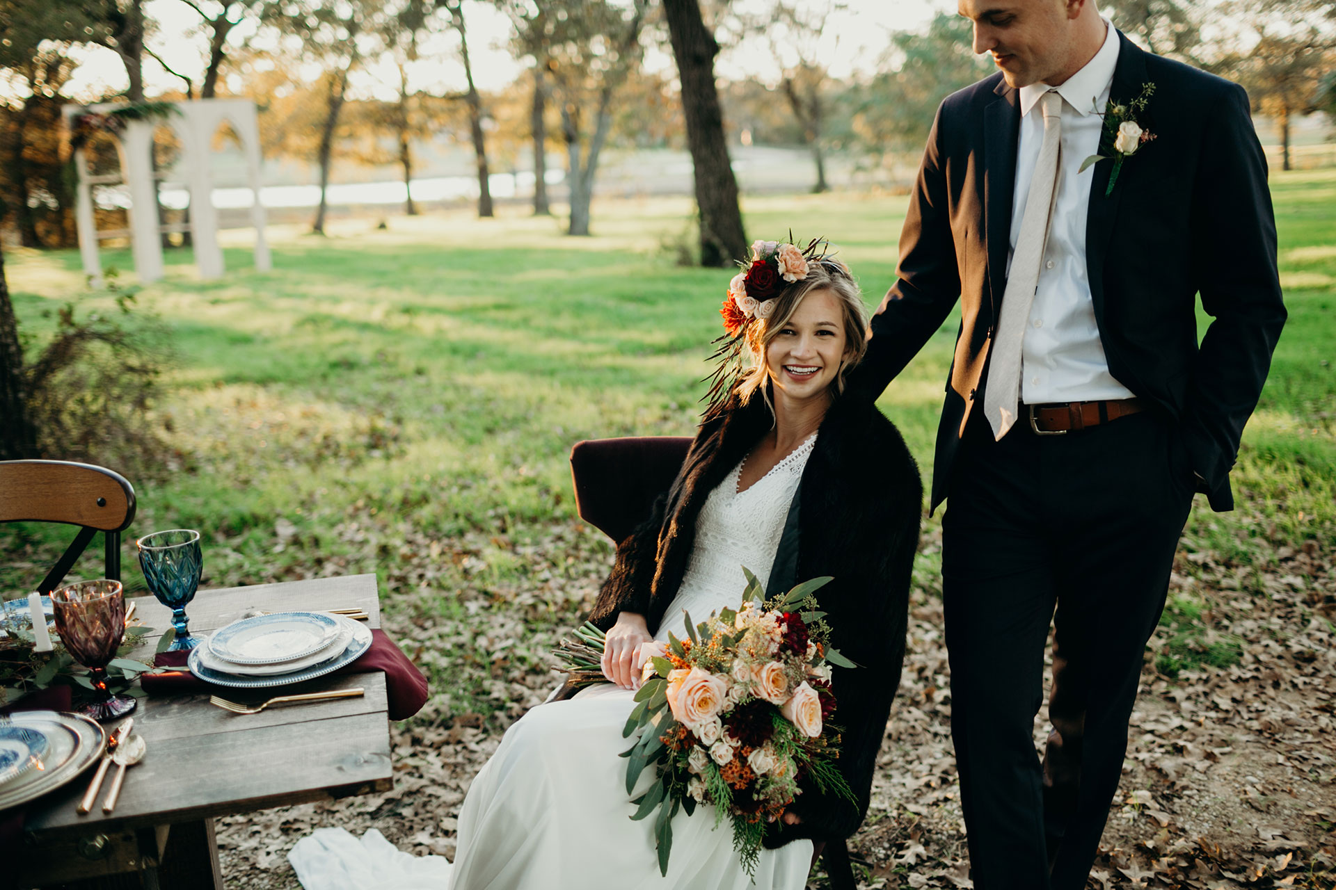 Bride and Groom Outdoors with Floral Arrangement, Surrounded by Mature Oaks