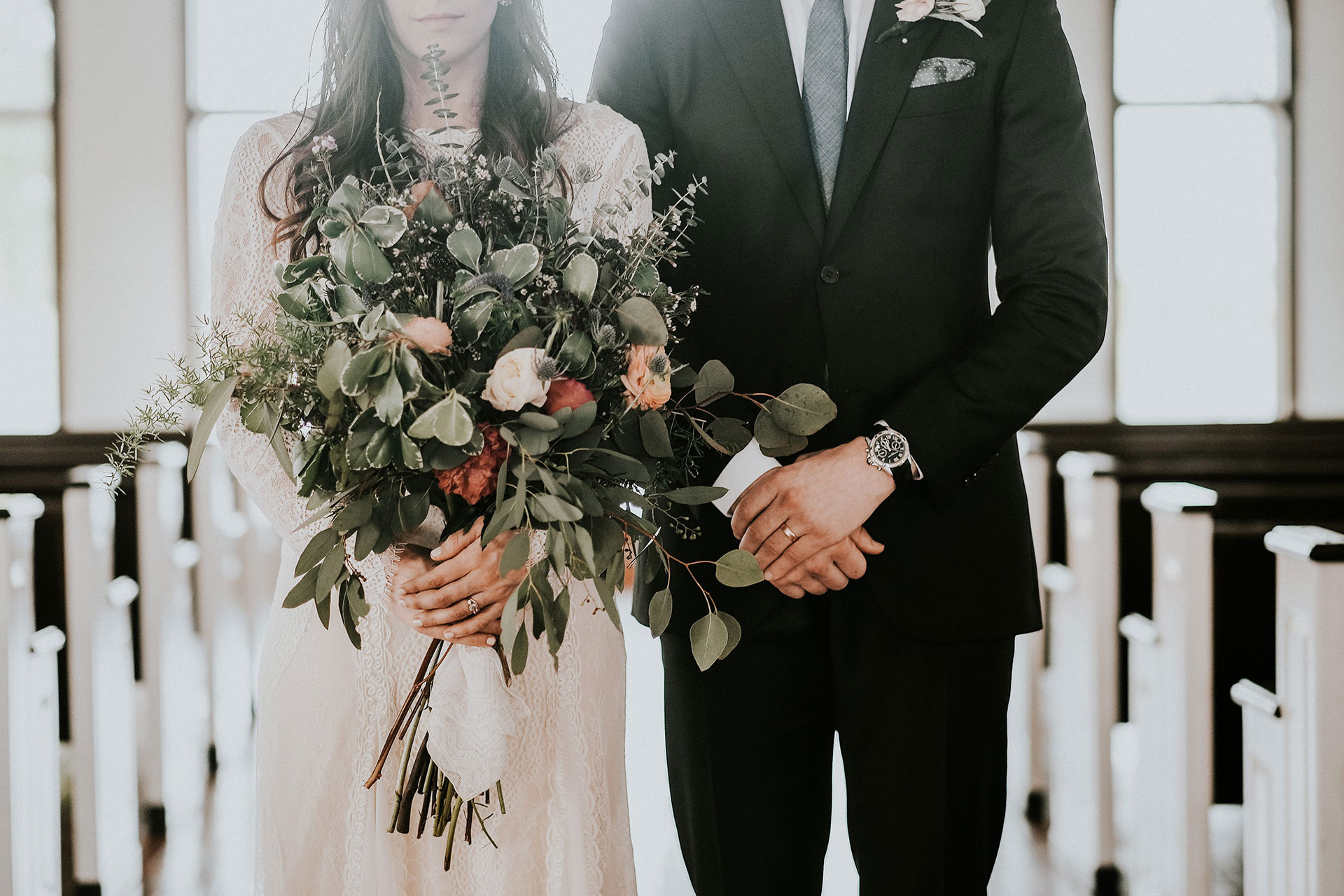 Bride and Groom Indoors with Beautiful Floral Arrangement