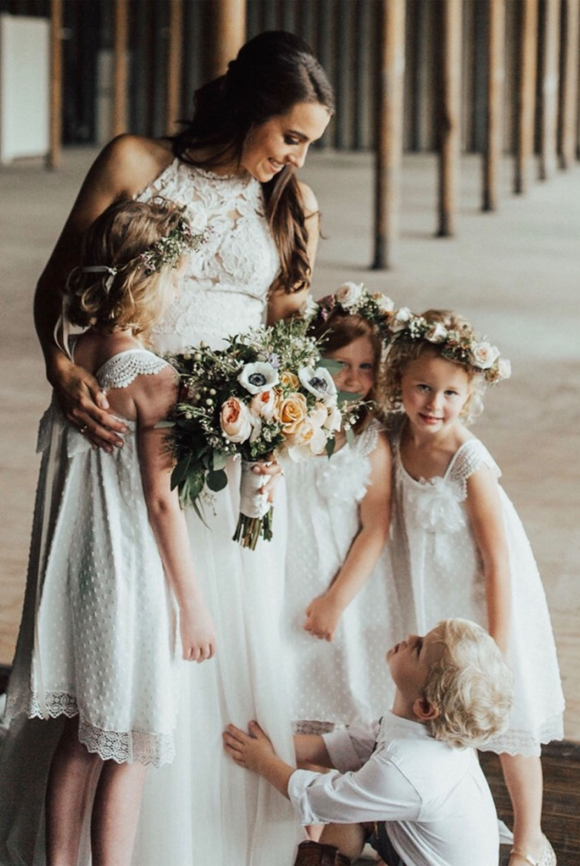 Wedding Bridesmaid in a white dress with beautiful floral arrangement.