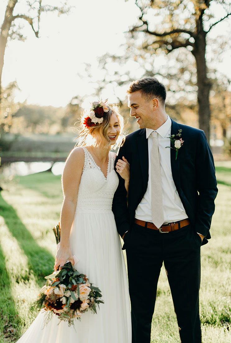 Bride and Groom Outdoors with Floral Arrangement